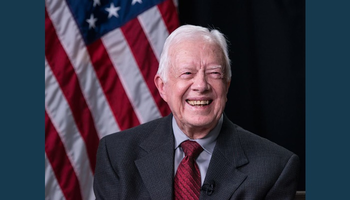 Jimmy Carter back on Habitat build site after dehydration scare