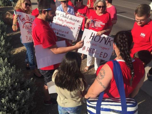 Defiant Arizona governor bends to Educator demands, Longer