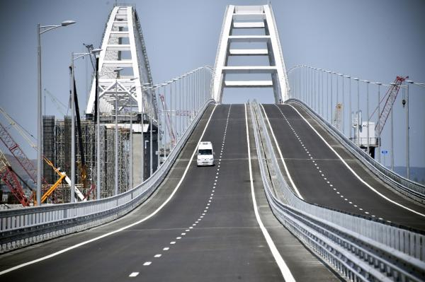 A car drives on the Kerch Strait Bridge over on Tuesday prior to its opening ceremony