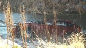 Spanish Fork Overturned car in Frigid River
