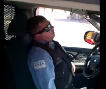 Chicago Police Officer Sleeping on the Job