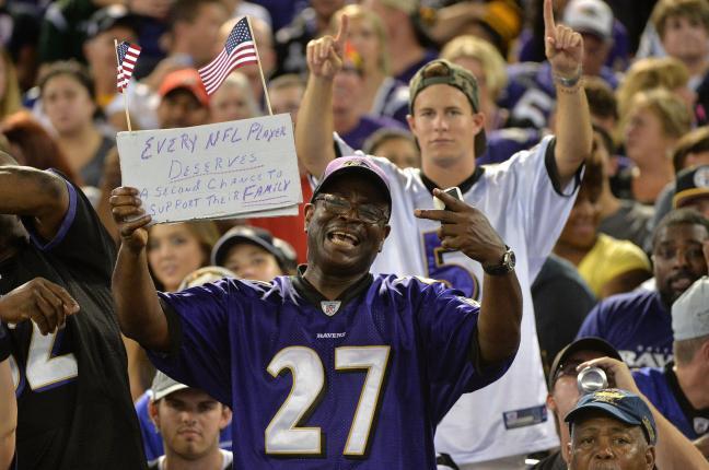 Baltimore Ravens Fan Holding Sign