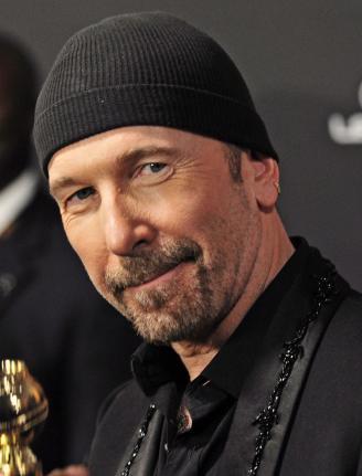 U2's The Edge Falls Off Stage