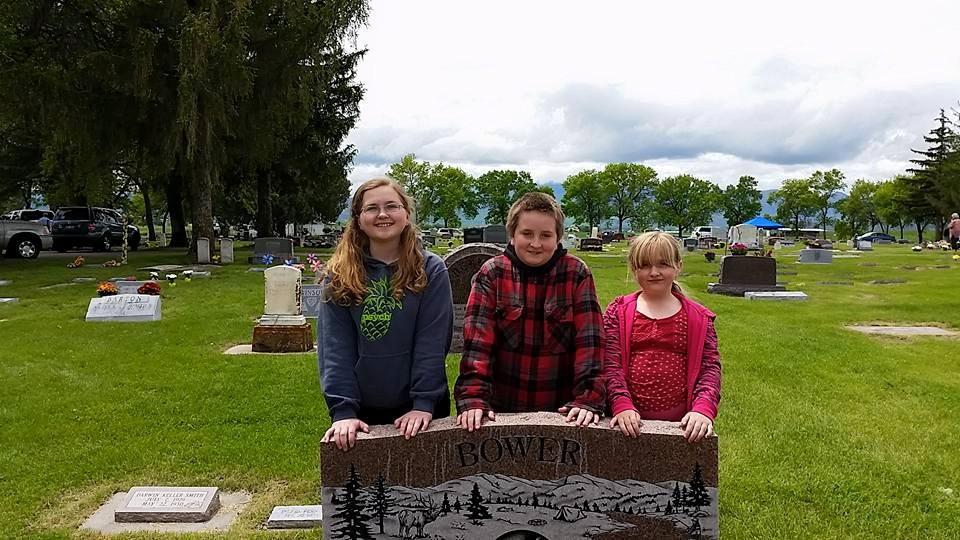 John Bower's children visiting his grave (photo courtesy Penny Bower)