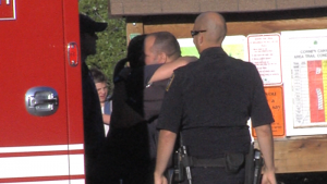 First responders console family members of Box Canyon H.S. teen found dead in hiking area. Photo: Gephardt Daily