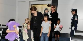 Angelina Jolie and Brad Pitt Fly Coach