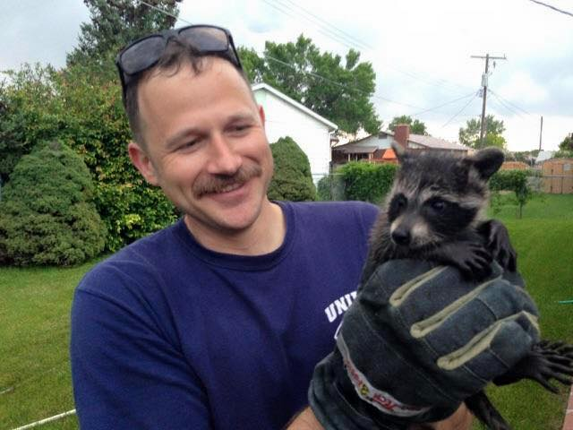 Unified Fire Dept and Baby Raccoon Rescued from Chimney. (Photo Courtesy Unified Fire Dept.)