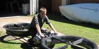 engineers pose on a hoberbike prototype