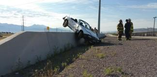 South Jordan Car Crash Lands on Concrete Barrier
