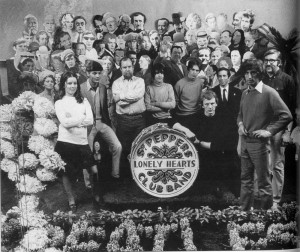 Jann Haworth (white sweater) and Peter Blake work on the Sgt. Pepper album cover. Photo Courtesy: Adam Cooper.