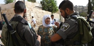 Israeli Border Police and Moslem Woman