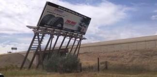 Truck Pulls Down Roadside Billboard