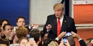 Trump-calls-for-mosque-surveillance-black-protester-assaulted-during-rally