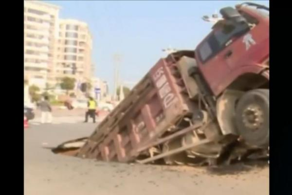 Road Collapses Beneath Overloaded Truck