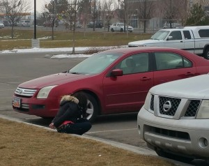 A suspect is arrested after a victim finds his stolen vehicle parked at Taylorsville High School. Photo: Gephardt Daily/Kurt Walter