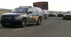 FBI agents, police officers, and lawmakers and clergymen who hoped to help negotiate a peaceful end to the standoff at the Malheur Wildlife Refuge gathered at the site on Thursday. The final four occupiers were taken into custody. Photo: Courtesy