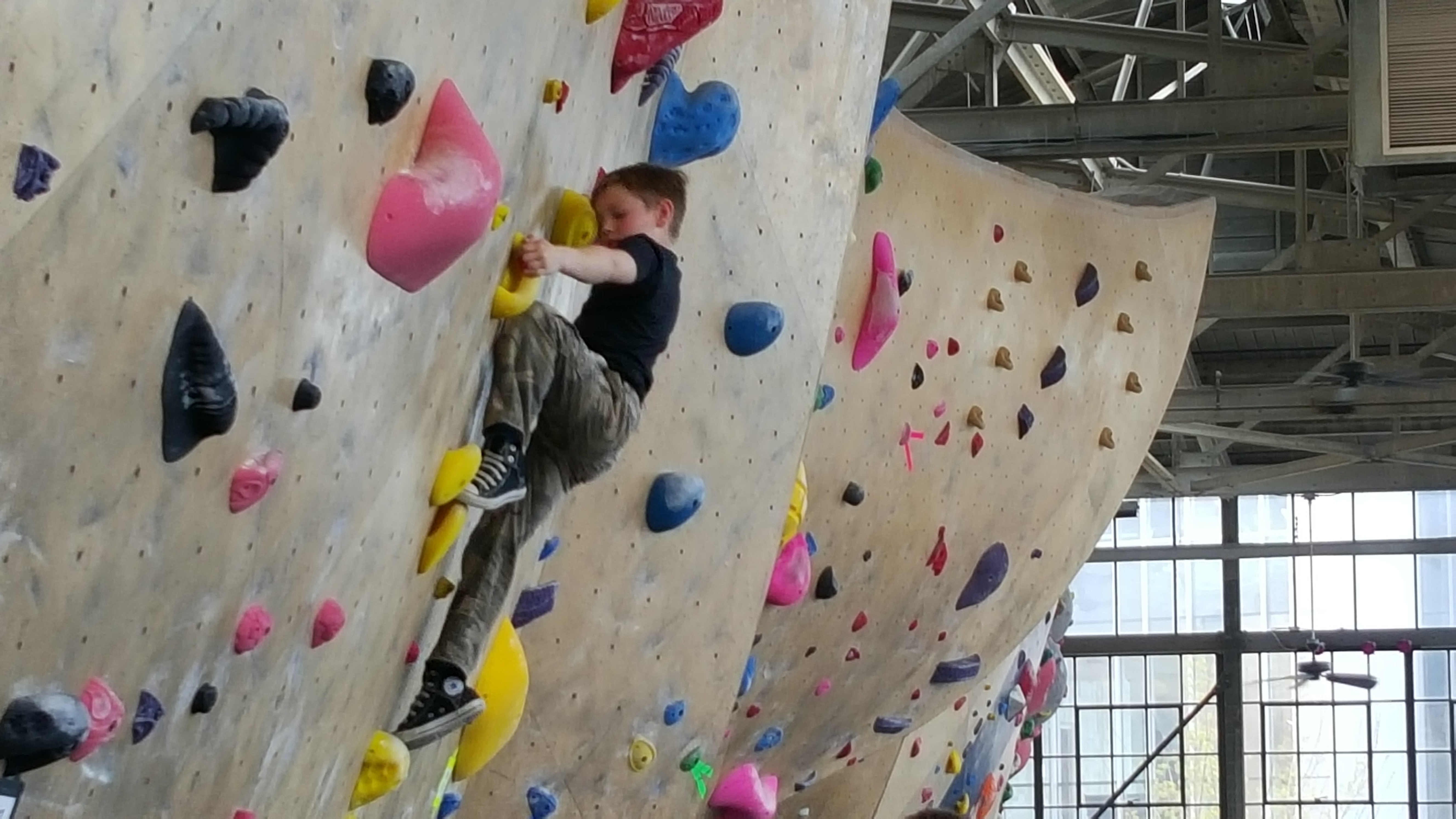Lincoln Anaya, 7, works the wall at the 2016 Ogden Climbing Festival. Photo: Gephardt Daily
