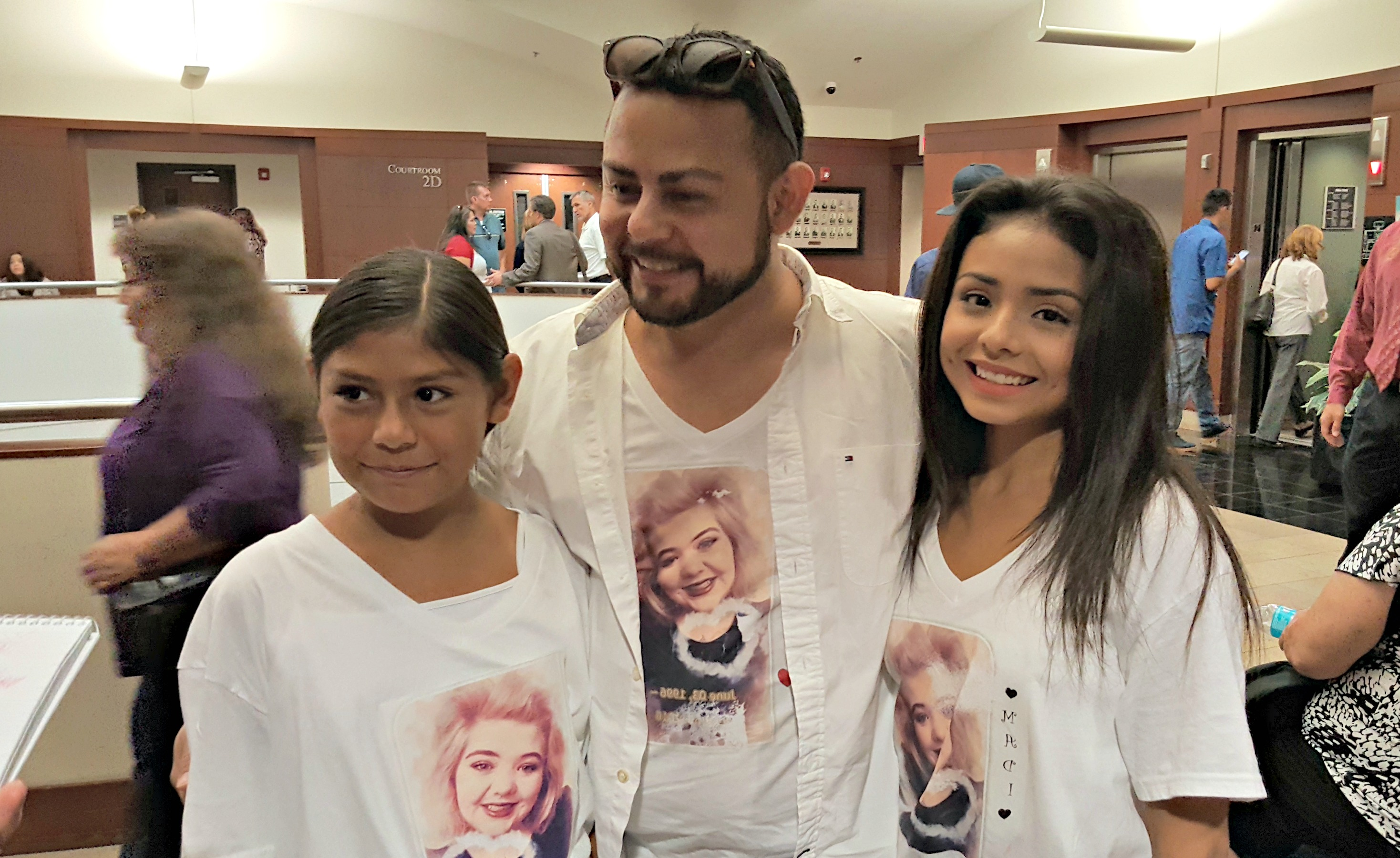 Alicia Castillo (left), 11, and Audrie Castillo, 18, show off the T-shirts their uncle Lee Castillo (center) made for them and other of Maddison Haan's family members to wear to court. Photo: Gephardt Daily