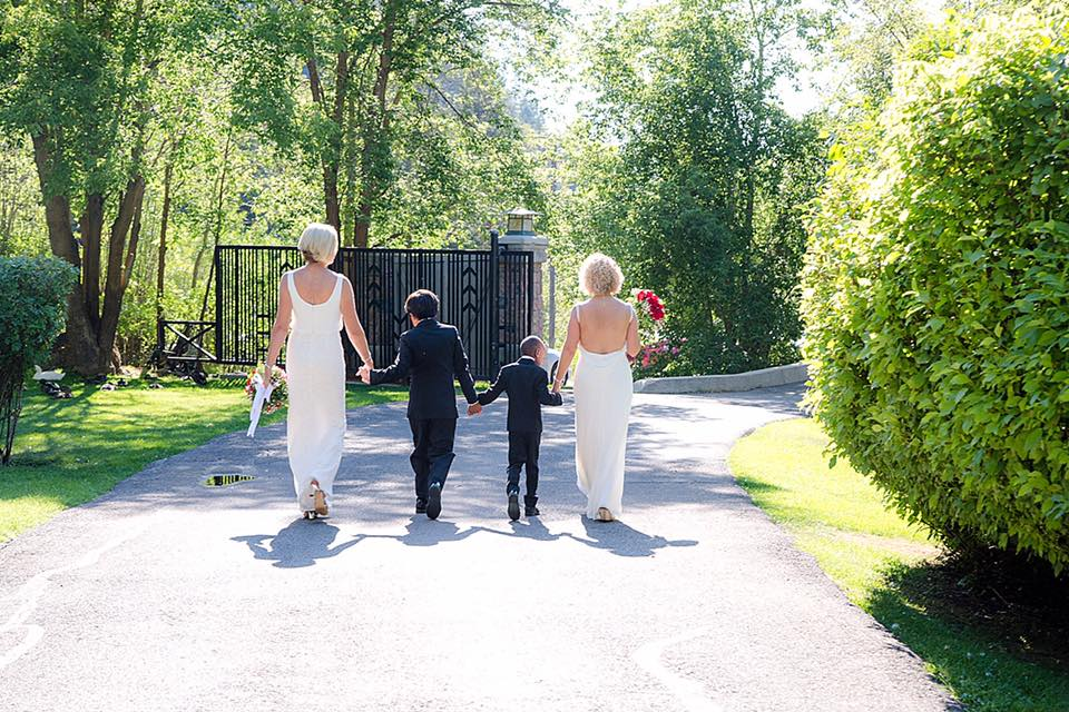 Betty Iverson and Mayor Jackie Biskupski, with their sons between them, are shown leaving their wedding. Photo: Facebook