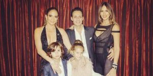 singer later reunited with Anthony backstage to pose for a family photo with their two children, 8-year-old twins Emme and Max. Anthony's wife, Shannon De Lima, joined the foursome for the snapshot