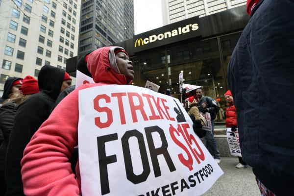 25 arrested for sitting in NYC street at minimum-wage rally