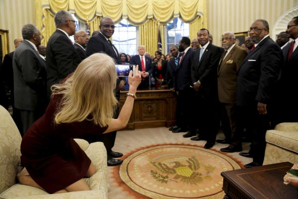 Kellyanne Conway apologizes for kneeling on Oval Office couch