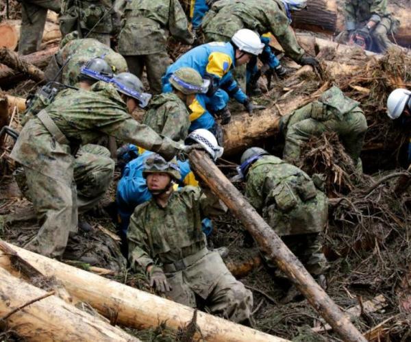 Death toll at 21 after floods, landslides hit Japan