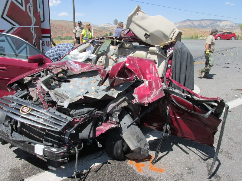 Woman flown to hospital after Cadillac hit by garbage truck ...