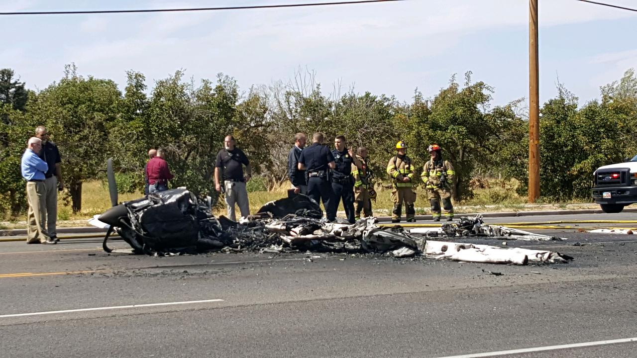 Investigators on the scene of a fiery plane crash on 1900 W near 4500 South in Roy
