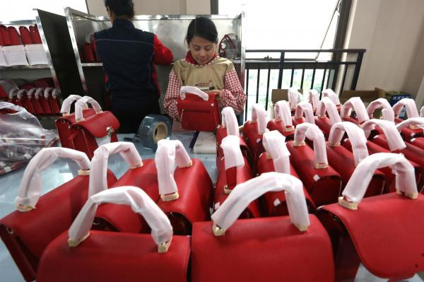 Chinese employees work in a high-end leather goods factory in Chengdu Sichuan Province China on November 21. File