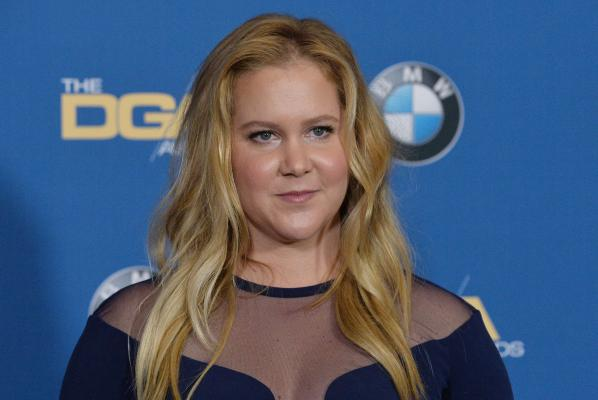 Amy Schumer secretly marries boyfriend Chris Fischer - see wedding pictures