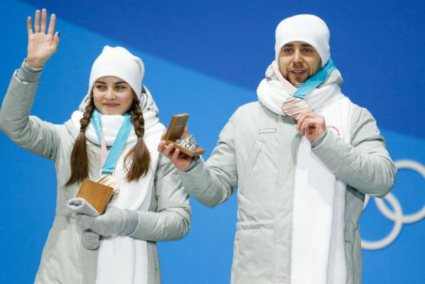 Russian curlers hand back Olympic medals amid doping probe