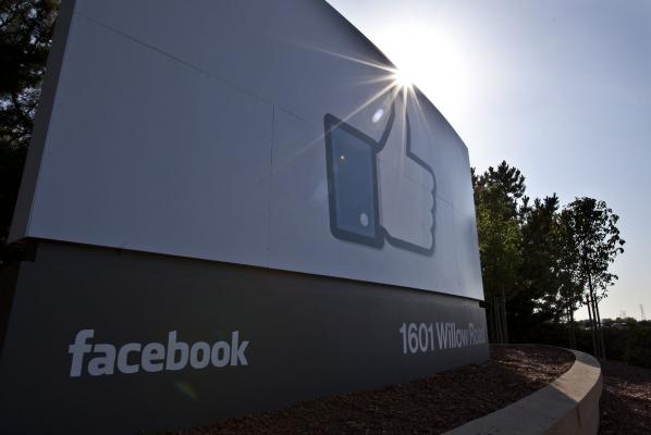 The Latest: Facebook to verify those behind political ads